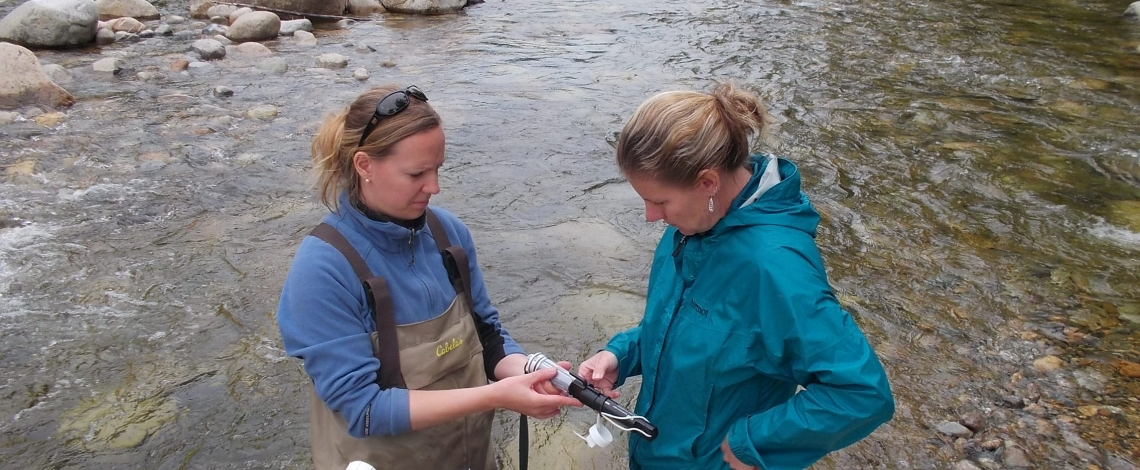 researchers collecting water samples