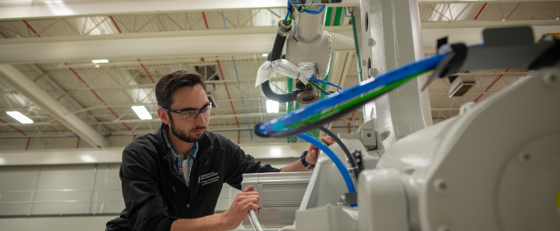UNH student Mike Locke working at the John Olson Advanced Manufacturing Center