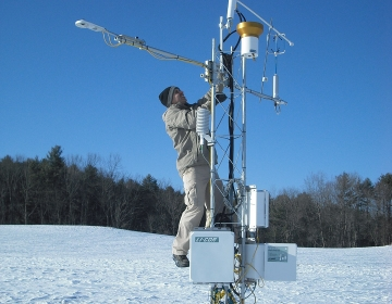 researcher working outdoors in the snow