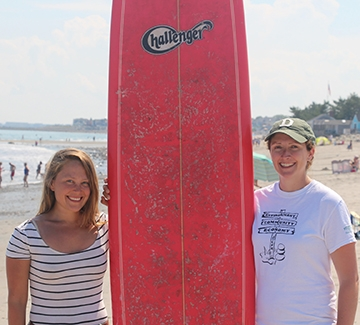 people posing with surf board