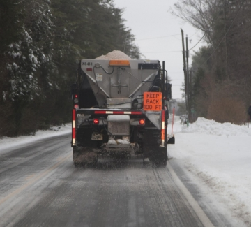truck salting road in winter