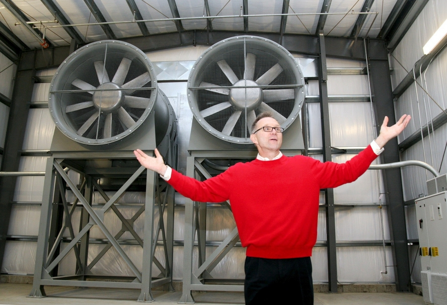 man posing in wind tunnel