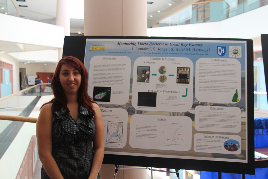 woman presenting research poster