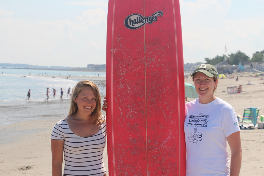 two people posing with surfboard