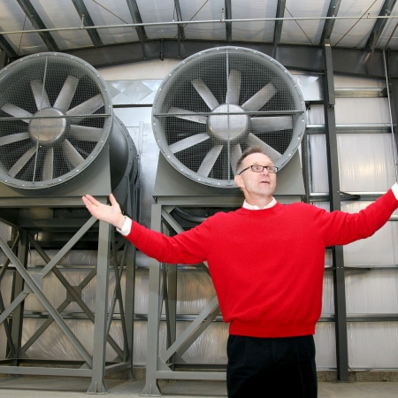 man posing in wind tunnel