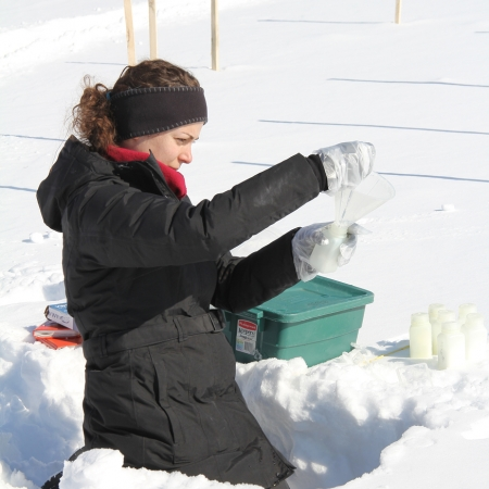 woman collecting samples in the snow