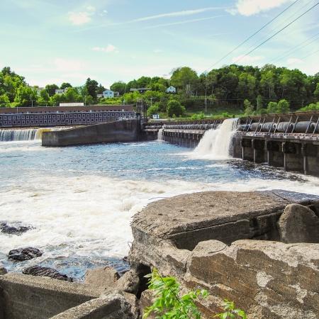 water flowing over dam